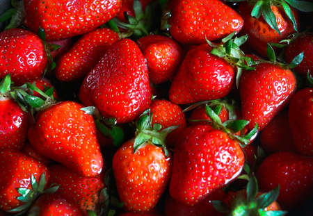 Closeup photography of fresh strawberry lying in the water.Top view,many fresh berries.Good for placing text.Food background.