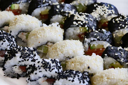 Set of sushi rolls-traditional japanese dish.Top view of assorted sushi.Food background.