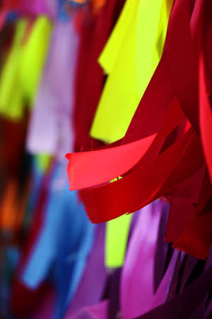 Abstract vertical background with multicolored satin ribbons.Children festival concept.