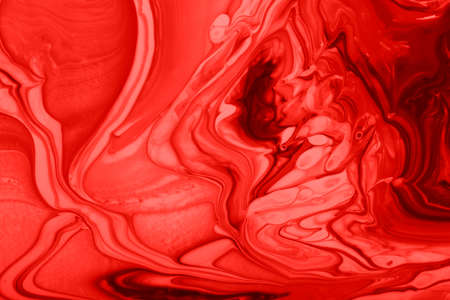 Monochrome red marble background.Mixed nail polishes, make up concept.Beautiful stains of liquid nail laquers.Fluid art, pour painting technique.Horizontal banner, can be used as backdrop for chat.