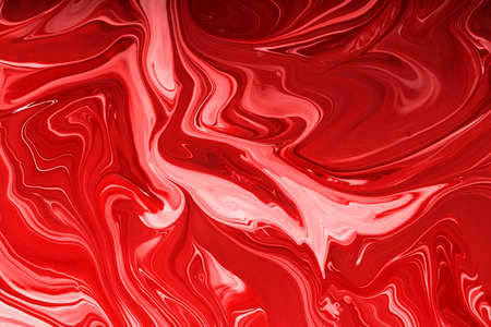 Abstract monochrome red background, make up concept.Beautiful stains of liquid nail laquers.Fluid art, pour painting technique.Good as digital decor, copy space.