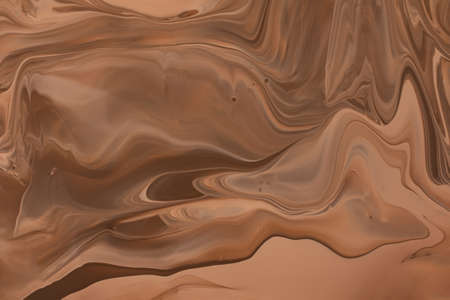 Abstract caramel color background.Make up concept.Beautiful stains of liquid nail laquers.Fluid art, pour painting technique.Good as digital decor or wallpaper for phone, copy space.