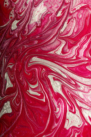 Raspberry pink shimmer abstract background. Make up concept.Beautiful stains of liquid nail laquers.Fluid art, pour painting technique.Vertical banner, can be used as backdrop for chat.