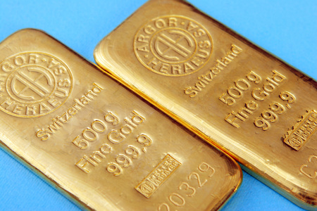 edel: Fine gold of a bank on blue background Editorial