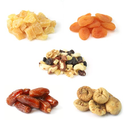 Dried fruits with nuts on white Stock Photo