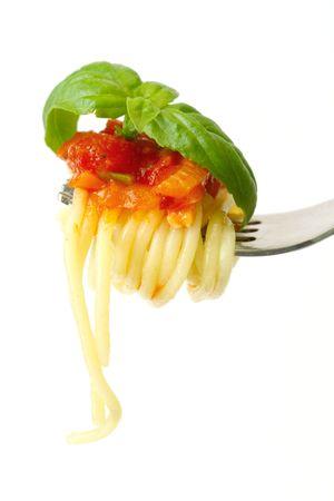 Spaghetti on fork with tomato sauce