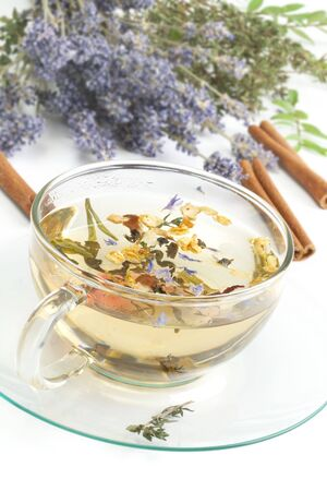 Herbal tea on background with lavender and cinnamon