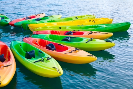 Group of colorful kayaks on water