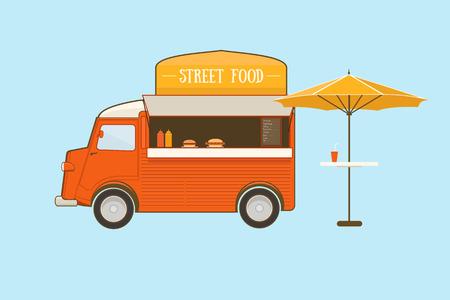 食べ物: 青の背景に傘のストリート フード トラック
