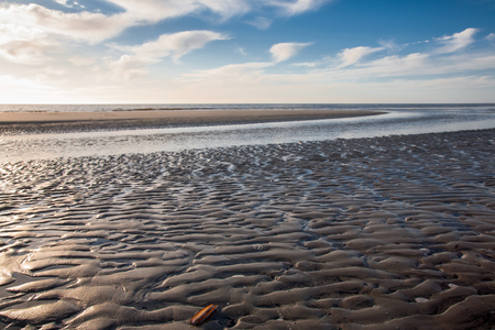 Low tide at sunset on North sea in North Germany Stock Photo