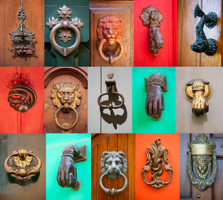 Set of old style door handle and door knockers on the front door