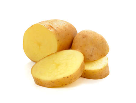 Fresh potatoe with slices isolated on white background