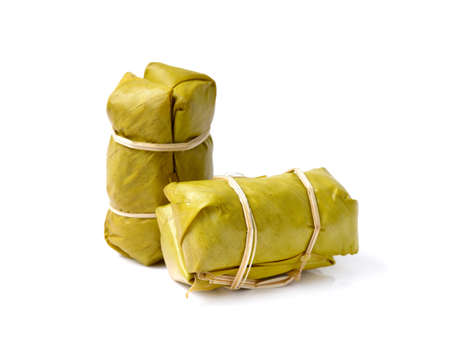 Sweet Thai sticky rice with banana ,Traditional Thai food style, Glutinous rice steamed in banana leaf ( Khao Tom Mat)