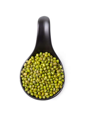 mung beans in spoon on white background Stock Photo