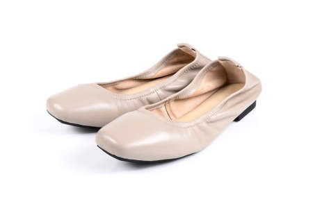 beige ladies' flat shoes on white background. Banque d'images