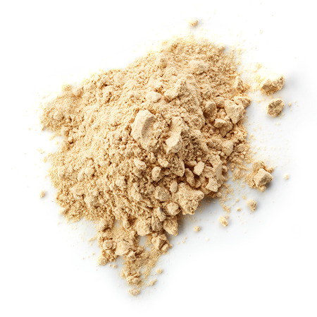 maca root: heap of maca powder isolated on white background
