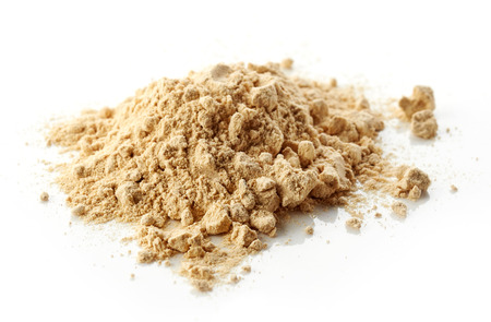 heap of maca powder isolated on white background