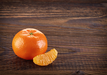 orange peel clove: Mandarin orange with slice on brown wooden table