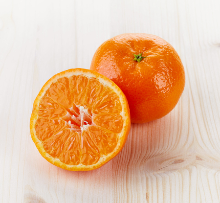 orange peel clove: Mandarin orange or tangerine on white wooden table Stock Photo