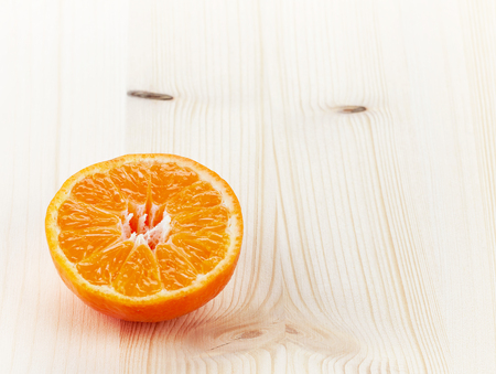 orange peel clove: Mandarin orange or tangerine half on white wooden table