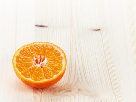 orange peel clove: Mandarin orange or tangerine half on white wooden table