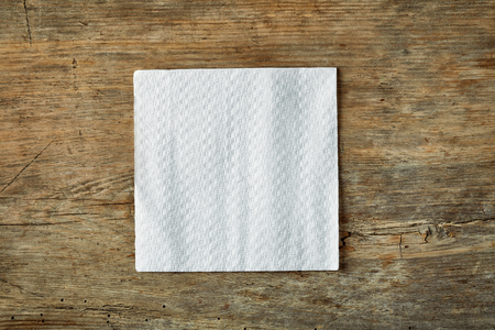 White paper napkin on wooden table, top view