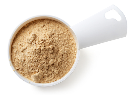maca: Measuring scoop of maca powder isolated on white background, top view Stock Photo