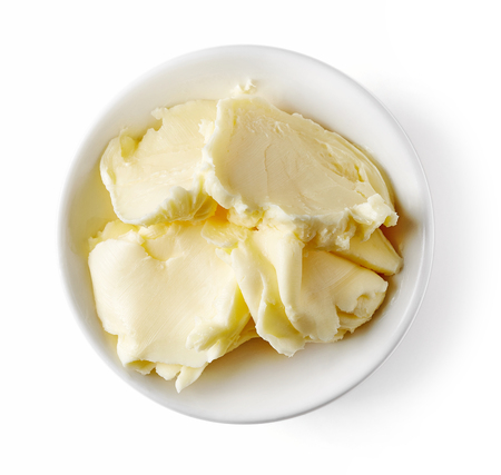 Bowl of butter isolated on white background, top view Stock Photo