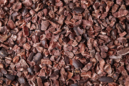 Cacao nibs background, close up Reklamní fotografie