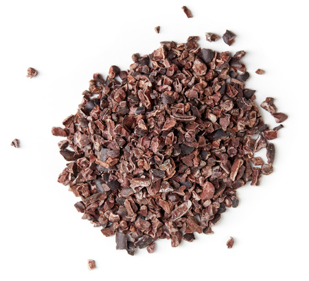 Heap of cacao nibs, isolated on white background, top view