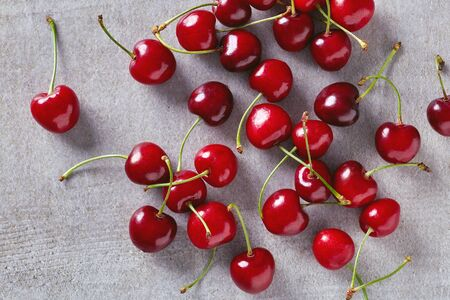 cherries isolated: Ripe red cherries on stone table, top view