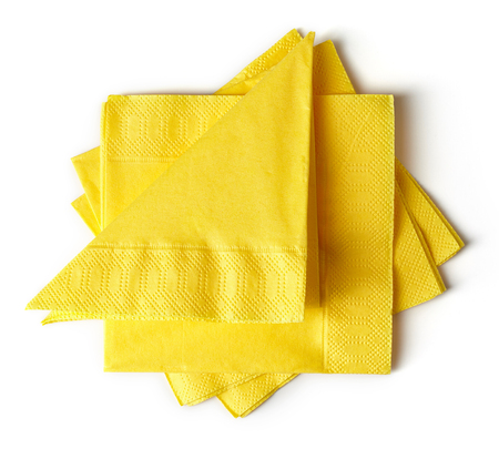servilletas: yellow paper napkins isolated on white background Foto de archivo