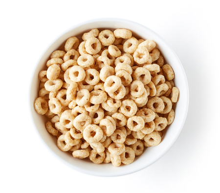 Bowl of Whole Grain Cheerios Cereal isolated on white background, top view