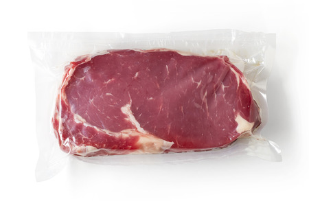 Vacuum sealed fresh beef steak for sous vide cooking isolated on white background, top view