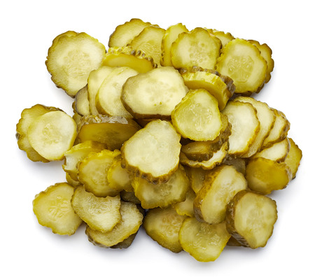 Heap of chopped pickled cucumber isolated on white, top view