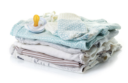 Pile of baby clothes isolated on white background