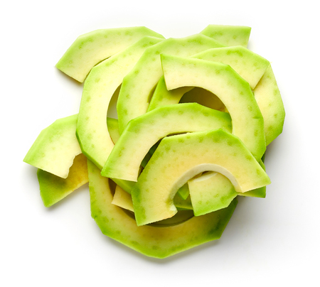 Heap of fresh avocado slices isolated on white background, top view