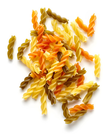 carbohydrates: Colored pasta isolated on white background, top view