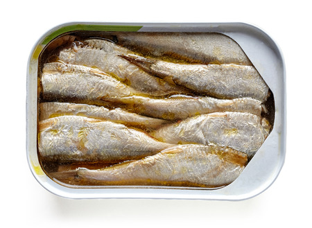 Open can of sprats in oil isolated on white background, top view