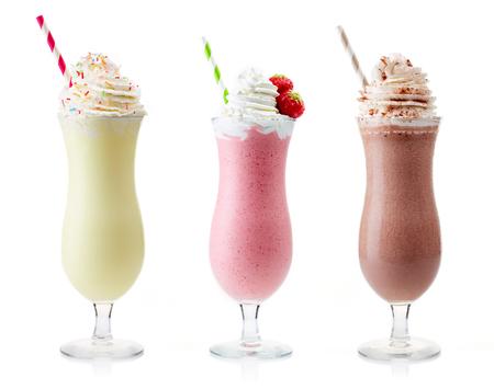 Strawberry, chocolate and vanilla milkshake with whipped cream isolated on white background
