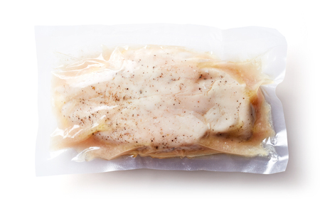 Chicken breast vacuum sealed ready for sous vide cooking isolated on white background, top view