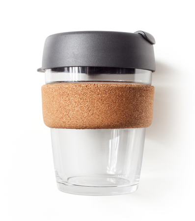 Reusable glass takeaway coffe cup with plastic lid isolated on white background, flat lay