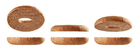 Halved fullgrain bagels levitating in different positions isolated on white background