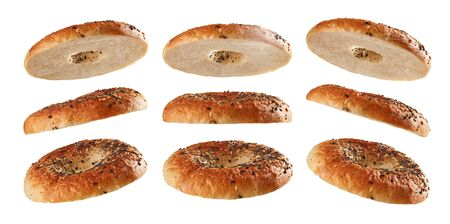 Halved bagel tops levitating in different positions isolated on white background Reklamní fotografie