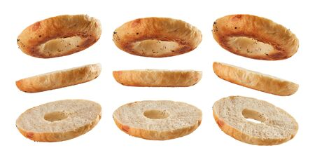 Halved bagel bottoms levitating in different positions isolated on white background