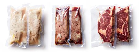 Duck breast, chicken breast and beef steak vacuum sealed ready for sous vide cooking isolated on white background, top view