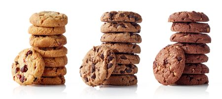 Three different piles of fresh chocolate chip cookies isolated on white background Reklamní fotografie