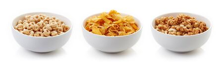 Three bowls of different cereals isolated on white background