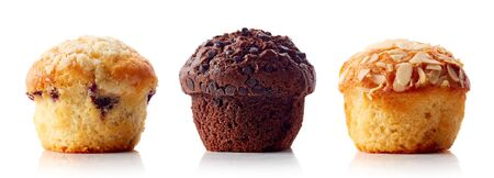 Assorted muffins in brown paper isolated on white background, top view