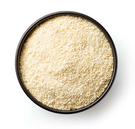 Bowl of breadcrumbs isolted on white, from above